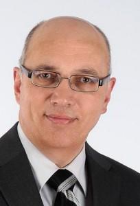 Dr. Walter Schoger, comFormer